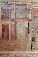 Fresco decoration of an architectural framework with statues, a tripod on a base and a woman on a balcony with her maidservant, on the North wall of the Frigidarium or cold pool of the baths in the Casa del Criptoportico, or House of the Cryptoporticus, Pompeii, Italy. This room is decorated in the Second Style of Pompeiian wall painting, 1st century BC. The house is one of the largest in Pompeii and was owned by the Valerii Rufi family and built in the 3rd century BC. It takes its name from the underground corridor or cryptoporticus used as a wine cellar and lit by small windows. Pompeii is a Roman town which was destroyed and buried under 4-6 m of volcanic ash in the eruption of Mount Vesuvius in 79 AD. Buildings and artefacts were preserved in the ash and have been excavated and restored. Pompeii is listed as a UNESCO World Heritage Site. Picture by Manuel Cohen