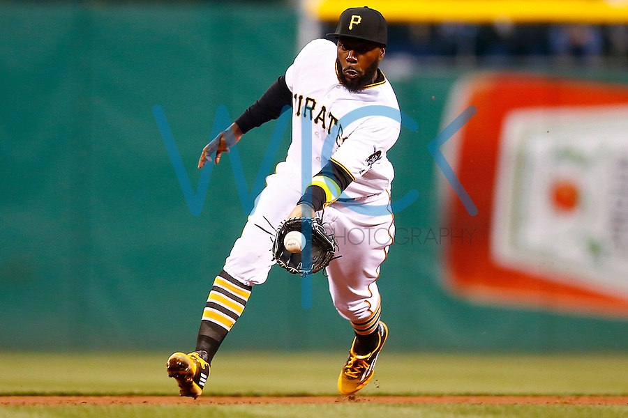 Josh Harrison #5 of the Pittsburgh Pirates picks up a ground ball against the St. Louis Cardinals during the game at PNC Park in Pittsburgh, Pennsylvania on April 5, 2016. (Photo by Jared Wickerham / DKPS)