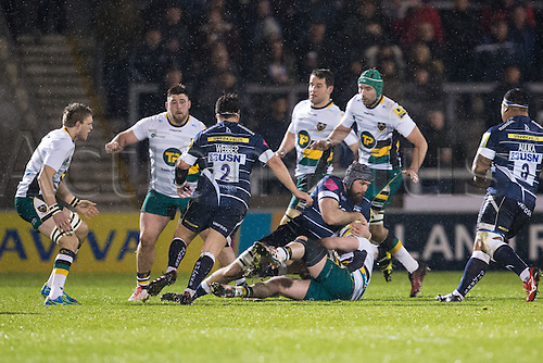 March 3rd 2017, Sale, Cheshire, England, Aviva Premiership Rugby, Sale Sharks versus Northampton Saints; Sale Sharks Bryn Evans is tackled