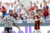 Calcio, Serie A: Roma vs Juventus. Roma, stadio Olimpico, 30 agosto 2015.<br /> Juventus&rsquo; Patrice Evra, left, kicks the ball past Roma&rsquo;s Alessandro Florenzi during the Italian Serie A football match between Roma and Juventus at Rome's Olympic stadium, 30 August 2015.<br /> UPDATE IMAGES PRESS/Riccardo De Luca