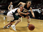 03/10/11--Tigard's Lexi Carter and Oregon City's Jade Lowery battle for a loose ball in the quarterfinals of girls 6A championship at the Rose Garden in Portland, Or. The Pioneers advanced to the semifinals with a score of 66-36...Photo by Jaime Valdez........................................