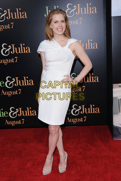 "AMY ADAMS.at The Columbia Pictures' Screening of  ""Julie & Julia"" held at The Mann's Village Theatre in Westwood, California, USA, July 27th 2009.                                                                  .full length white dress hand on hip shoes twist strap neckline platform heels .CAP/DVS.©Debbie VanStory/RockinExposures/Capital Pictures"