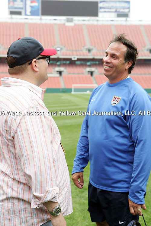 25 May 2006,  Coach, Bruce Arena (L) talks with Drew Carey (R) after practice.  The USA Mens National soccer team held a practice session before taking on Venezuela in an international friendly match at Cleveland Browns Stadium in Cleveland, Ohio in their preparation for competition at World Cup 2006 in Germany.