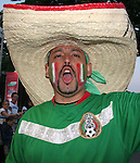 16 June 2006: A Mexico fan in a sombrero watches the Mexico game at FIFA Fan Fest in Frankfurt, site of several games during the FIFA 2006 World Cup.