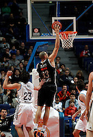Real Madrid's Sergio Llull and Brose's Maik Zirbes during Euroliga match. February 28,2013.(ALTERPHOTOS/Alconada)