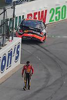 Oct 5, 2008; Talladega, AL, USA; NASCAR Sprint Cup Series driver Martin Truex Jr (1) walks away from his car after crashing during the Amp Energy 500 at the Talladega Superspeedway. Mandatory Credit: Mark J. Rebilas-
