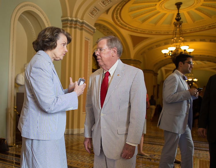 UNITED STATES - JUNE 11 - Sen. Dianne Feinstein, D-Calif. speaks with Sen. Johnny Isakson, R-Ga. after they take a group photograph in the Ohio Clock Corridor in celebration of National Seersucker Day on Thursday, June 11, 2015. Continuing the tradition introduced by Sen. Trent Lott (R-MS) in 1996, Dr. Cassidy reintroduced National Seersucker Day in the U.S. House of Representatives in 2014 and is continuing the tradition in the U.S. Senate. (Photo By Al Drago/CQ Roll Call)