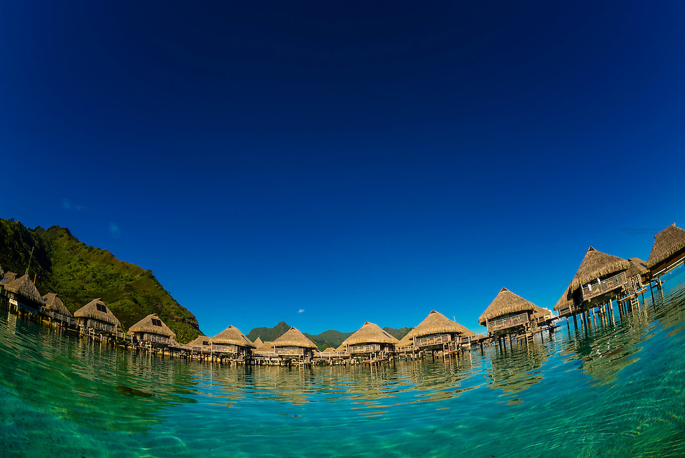 View Of The Overwater Bungalows In The Lagoon From Inside