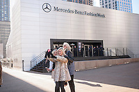 Fashionistas brave the frigid weather to do their obligatory selfies outside the Fall 2015 Fashion Week shows in Lincoln Center in New York on Friday, February 13, 2015. The day started off in the single digits reaching the mid-teens and Sunday is expected to go down to zero, the coldest day in the city in 20 years. This is the last time the shows will be at Lincoln Center as they were booted after a lawsuit was won about them denying use of the park to the public. A new venue has not been determined yet. (© Richard B. Levine)