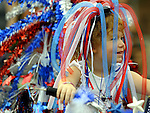 Megan Carcia, 4, of Ellington (Carcia)  smiles through the  red, white and blue streamers she wearing on her head, prior to the step off of the kids parade  in Rockville, Tuesday, July 3, 2012, during Vernon's July 4tn celebration. (Jim Michaud/Journal Inquirer)