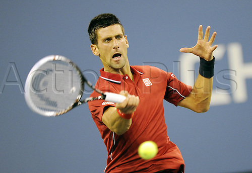 25.08.2014. Flushing Meadows, NY, USA.  Novak Djokovic of Serbia returns a shot during the men s singles 1st round match against Diego Schwartzman of Argentina at the U.S. Open tennis tournament in New York, the United States, on Aug. 25, 2014. Djokovic won 3-0.