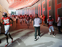 Ohio State Buckeyes head coach Urban Meyer and his players walk leave the tunnel for warm ups before the college football game between the Ohio State Buckeyes and the Virginia Tech Hokies at Ohio Stadium in Columbus, Saturday afternoon, September 6, 2014. The Virginia Tech Hokies defeated the Ohio State Buckeyes 35 - 21. (The Columbus Dispatch / Eamon Queeney)