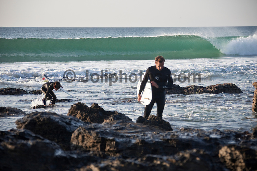 Former World Professional Surfing Champion TOM CURREN (USA) with his son PAT CURREN (USA)Surfing at Jeffreys Bay, (Saturday 11th July 2009), Eastern Cape, South Africa ,   Photo: joliphotos.com