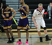 Brady Flynn (right), Birmingham Seaholm, celebrates a hard fought victory as Dominic Kejbou (10) and Ty Bland, Auburn Hills Avondale, walk off the court following a 54-48 loss to the Maples during district semifinal basketball action at Bloomfield Hills High School Wednesday, March 8, 2017. 2017. Flynn also scored a game high 22 points in the winning effort. 2017.Photos: Larry McKee, L McKee Photography. PLEASE NOTE: BEFORE PURCHASING AN IMAGE, PLEASE CHOOSE PROPER PRINT FORMAT TO BEST FIT IMAGE DIMENSIONS. L McKee Photography, Clarkston, Michigan. L McKee Photography, Specializing in Action Sports, Senior Portrait and Multi-Media Photography. Other L McKee Photography services include business profile, commercial, event, editorial, newspaper and magazine photography. Oakland Press Photographer. North Oakland Sports Chief Photographer. L McKee Photography, serving Oakland County, Genesee County, Livingston County and Wayne County, Michigan. L McKee Photography, specializing in high school varsity action sports and senior portrait photography.