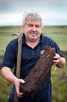 Port Ellen, Islay, Hebrides, United Kingdom, July 2013. Lagavulin Warehouseman Iain McArthur shows us how you dig peat and then lets us taste the single malt whiskies.Iain has become a celebrated figure to thousands of devotees of Lagavulin, especially those who make the pilgrimage to Islay and participate in his warehouse tours. Islay is an island on the Hebrides of scotland and is known for the peaty whisky that is being distilled here. It is the first time that Tallship Thalassa, a barquentine sailing vessel with 3 masts, sails from Belfast to Galway along the Irish coastline. While a full-rigged ship is square-rigged on all three masts, and the barque is square-rigged on the foremast and main, the barquentine extends the principle by making only the foremast square-rigged. The advantages of a smaller crew, good performance before the wind and the ability to sail relatively close to the wind while carrying plenty of cargo made it a popular rig at the end of the 19th century. Photo by Frits Meyst/Adventure4ver.com