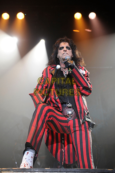 Alice Cooper.Performing live in concert, Wembley Arena, London, England. .28th October 2012.on stage in concert live gig performance performing music half length black red shirt suit stripe singing gloves skull belt buckle full leg foot up.CAP/MAR.© Martin Harris/Capital Pictures.