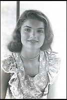 BNPS.co.uk (01202 558833)<br /> Pic: RRAuctions/BNPS<br /> <br /> Candid never before seen photos of Jackie Kennedy as a 16 year old have come to light.<br /> <br /> The snaps are believed to have been taken in the summer of 1945 at The Homestead, a luxury holiday resort in Hot Springs, Virginia.<br /> <br /> At the time, Jackie, who would later marry US president John F Kennedy, was between terms at the prestigious Miss Porter's School in Connecticut, US.<br /> <br /> They are being sold at auction alongside a heart-wrenching letter penned by Jackie just nine days after the assassination of JFK.