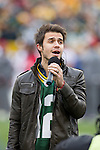 2011 American Idol winner Kris Allen sings the National Anthem prior to the Green Bay Packers Week 11 NFL football game against the Tampa Bay Buccaneers on November 20, 2011 in Green Bay, Wisconsin. The Packers won 35-26. (AP Photo/David Stluka)