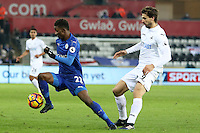 Demarai Gray of Leicester City is closely marked by Fernando Llorente of Swansea City during the Premier League match between Swansea City and Leicester City at The Liberty Stadium, Swansea, Wales, UK. Sunday 12 February 2017
