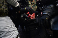 A protester has just been shot and is heavily bleeding.  Death and injury toll raise every hour on the hour in Maidan square since the violent repression started. Kiev, Ukraine