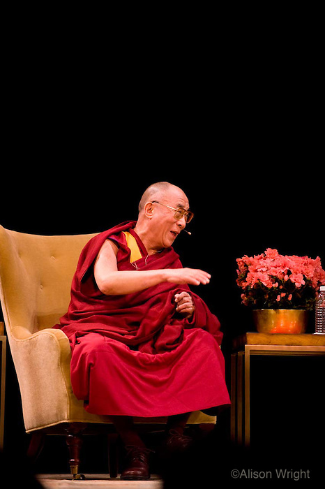 Th Dalai lama speaking with Mary Robinson and Pico Iyer at Town hall.