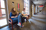 McKenna Mossman and Charlie Butterworth talk marketing in Holman Hall.  Photo by Kevin Bain/Ole Miss Communications