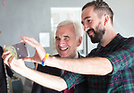 © Joel Goodman - 07973 332324 . 25/09/2016 . Liverpool , UK . Shadow Chancellor JOHN MCDONNELL poses for a selfie with LIAM KELLY (right) , director of Make Liverpool , during a visit . Make Liverpool is an open access workshop and maker space , free to use for the people of North Liverpool , on Trafalgar Dock , during the first day of the Labour Party Conference . Photo credit : Joel Goodman