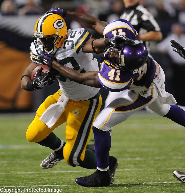 Green Bay Packers running back Brandon Jackson, left, stiff arms Minnesota Vikings' Frank Walkeron a run during the third quarter of the game at the Hubert H. Humphrey Metrodome in Minneapolis, Minn. on Nov. 21, 2010.