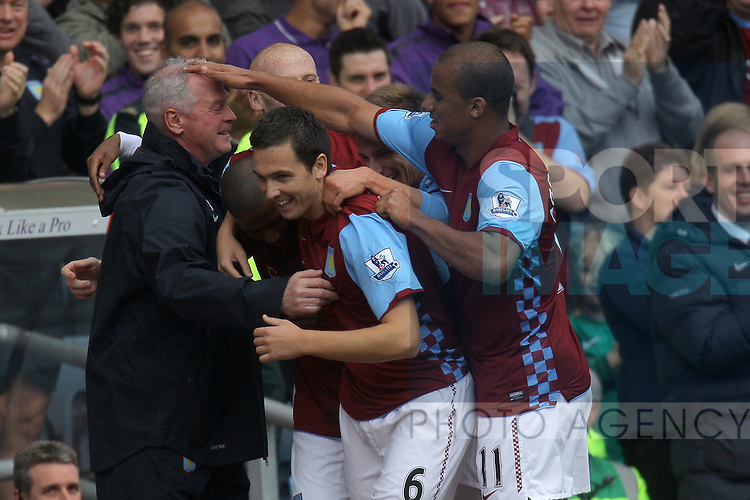 Villa caretaker manager Kevin MacDonalkd gets a pat on the head from Gabriel Agbonlahor following Ashley Young's goal