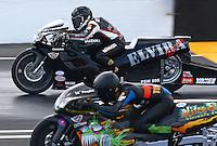 May 31, 2014; Englishtown, NJ, USA; NHRA pro stock motorcycle rider Elvira Karlsson (top) during qualifying for the Summernationals at Raceway Park. Mandatory Credit: Mark J. Rebilas-