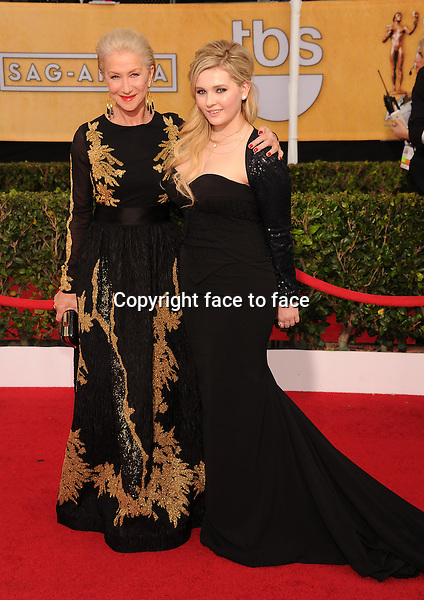 LOS ANGELES, CA- JANUARY 18: Actresses Helen Mirren and Abigail Breslin arrive at the 20th Annual Screen Actors Guild Awards at The Shrine Auditorium on January 18, 2014 in Los Angeles, California.<br />
