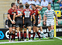 London, England. Saracens celebrate the try of Adam Powell of Saracens during the Aviva Premiership match between London Wasps  and Harlequins at Twickenham Stadium on September 1, 2012 in Twickenham, England..