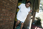November 20, 2007. Raleigh, NC.. As social security disability applications have reached an estimated 750,000 outstanding nation-wide many individuals have been waiting years to hear about their claims, as there conditions worsen and some have lost their homes to foreclosure and eviction.. Belinda Virgil, at her daughter's home. She moves between here and a friend's, as she lost her home when her health costs prevented here from paying the rent. She is on a constant oxygen stream to treat her emphysema and must pull the 150 ft. cord with her even as she goes outside with great effort.