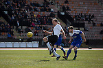 Home captain Dougie Gair opens the scoring in the Scottish pyramid play-off second leg between Edinburgh City (in white) and Cove Rangers at the Commonwealth Stadium at Meadowbank in Edinburgh. The match between the champions of the Lowland and Highland Leagues determined which club would play-off against East Stirlingshire for a place in the Scottish league. The second leg ended 1-1, giving Edinburgh City a 4-1 aggregate win.