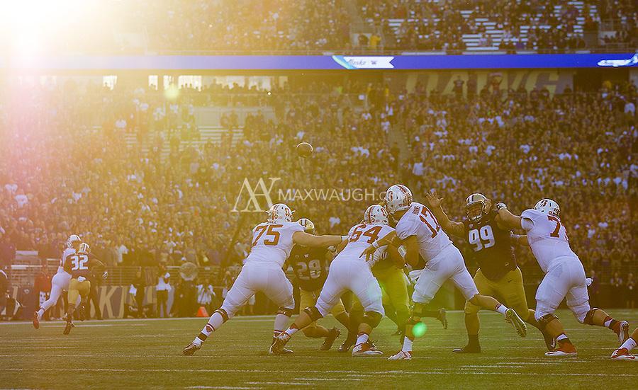 Cardinal quarterback Ryan Burns starts off the game with a pass.