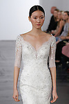 Model walks runway in a sweetheart 3/4 length sleeve fit and flare bridal gown with beaded lace embroidery from the Dennis Basso for Kleinfeld 2018 Bridal Collection on October 5 2017, during New York Bridal Fashion Week.