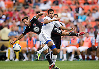 Josh Wolff (16) of D.C. United fights for the ball with Steven Beitashour (33) of the San Jose Earthquakes during the game at RFK Stadium in Washington, DC.  D.C. United was defeated by the San Jose Earthquakes, 4-2.