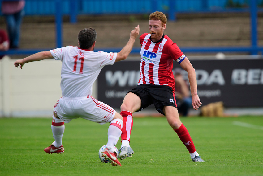 Lincoln City's Cian Bolger vies for possession with Lincoln United's Kallum Smith<br /> <br /> Photographer Chris Vaughan/CameraSport<br /> <br /> Football Pre-Season Friendly (Community Festival of Lincolnshire) - Lincoln City v Lincoln United - Saturday 6th July 2019 - The Martin & Co Arena - Gainsborough<br /> <br /> World Copyright © 2018 CameraSport. All rights reserved. 43 Linden Ave. Countesthorpe. Leicester. England. LE8 5PG - Tel: +44 (0) 116 277 4147 - admin@camerasport.com - www.camerasport.com