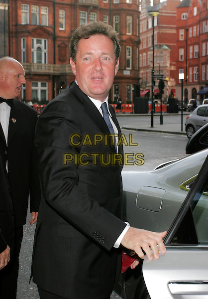 PIERS MORGAN.Arrivals at the 4th Aunnual Glamour Women Of The Year Awards, Berkely Square Gardens, London, England, .June 5th 2007..half length black suit over shoulder.CAP/AH.©Adam Houghton/Capital Pictures.