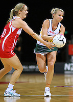 South Africa's Nadia Uys, right, gets the ball ahead of England's Sara Bayman in the New World Quad series netball match, Claudelands Arena, Hamilton, New Zealand, Thursday, November 01, 2012. Credit:SNPA / Dianne Manson.