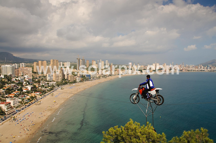 **ALL ROUND EXCLUSIVE PICTURES FROM SOLARPIX.COM**                                             **WORLDWIDE SYNDICATION RIGHTS**                                                                                  World famous tightrope walker Mustafa Danger teeters on the brink of a world record - but gets stuck 610ft above a Spanish beach during his World Guinness Record attempt at crossing a steel cable hanging from the Gran Bali Hotel through the Monte Tossal overlooking Benidorm's Poniente Beach. .Mustafa and his trusting assistant, acting as ballast, ground to a halt a few feet from their target in Benidorm when the steel wire wound towards its anchor-point at 43 storeys. The climb was too much for the bike and the pair were towed to safety. Thousands on the beach below feared the rider had failed, but the distance was measured and it was confirmed that as he had travelled more than one kilometre (1,640ft)  in distance and at a height of 186 meters he had been successful in his world record attempt..This pic:      Mustafa Danger                                                                                            JOB REF: 12323       BFY       DATE:  16.10.2010                                                          **MUST CREDIT SOLARPIX.COM OR DOUBLE FEE WILL BE CHARGED**                                                                      **MUST AGREE FEE BEFORE ONLINE USAGE**                               **CALL US ON: +34 952 811 768 or LOW RATE FROM UK 0844 617 7637**
