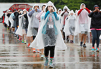 NWA Democrat-Gazette/DAVID GOTTSCHALK   Margaret Matheny, a piccolo player, practices marching Wednesday, August 19, 2015 in the rain with the Razorback Marching Band on the campus of the University of Arkansas in Fayetteville. The 350 member band is now under the direction Ben Lorenzo.