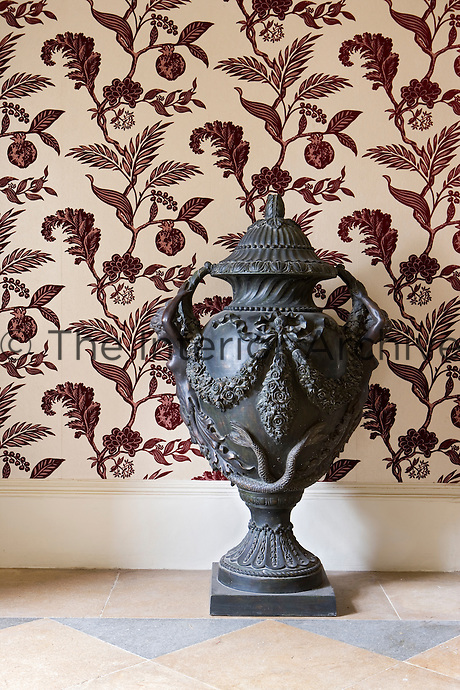 Close-up of black cast iron urn in entrance hall