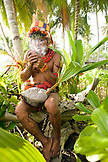 INDONESIA, Mentawai Islands, Kandui Resort, a male healer named Tak Kuanen from the Sakobou tribe, smoking a hand rolled cigarette