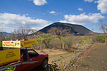 A view of the active volcano, Cerro Negro and a Bigfoot Hostel pick-up truck, which brings backpackers to the base, Nicaragua
