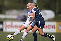 Sanford, FL - Saturday Oct. 14, 2017:  A Pride player passes the ball away from pressure during a US Soccer Girls' Development Academy match between Orlando Pride and NC Courage at Seminole Soccer Complex. The Courage defeated the Pride 3-1.