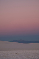 The sun sets at White Sands National Monument near Alamogordo, New Mexico, USA, on Fri., Dec. 29, 2017.