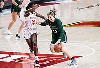 COLLEGE PARK, MD - DECEMBER 8: Isabella Therien #13 of Loyola dribbles past Diamond Miller #14 of Maryland during a game between Loyola University and University of Maryland at Xfinity Center on December 8, 2019 in College Park, Maryland.