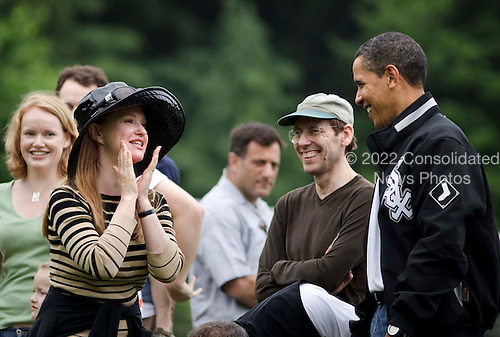 Washington, DC - May 16, 2009 -- United States President Barack Barack Obama joins other parents as he watches his daughter, Sasha play in a soccer game Saturday, May 16, 2009 in Washington DC.  .Credit: Brendan Smialowski / Pool via CNP