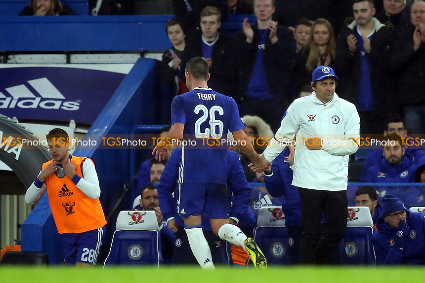 John Terry of Chelsea walks past his Manager, Antonio Conte, as he heads to the dressing room after being sent off during Chelsea vs Peterborough United, Emirates FA Cup Football at Stamford Bridge on 8th January 2017